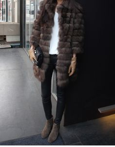 Love the fur and the leather jeans but I would wear other shoes and change the bag! #leather #fur