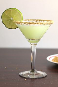 Key Lime Martini cocktail with vanilla vodka, key lime juice, coconut, pineapple, and cream.  Get this drink recipe at http://mixthatdrink.com/key-lime-martini/
