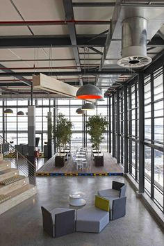 The interior of this office space has been designed so that employees can use it for meetings or informal teamwork.