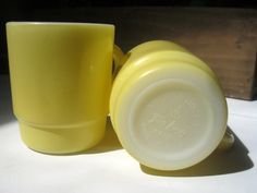 Two Vintage Fire King Butter Yellow Coffee Mugs
