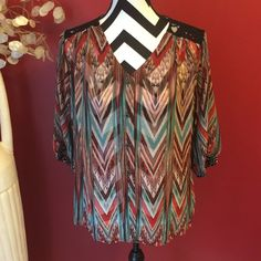 Beautiful multicolored boutique top never worn it's semi sheer L&M Boutique Tops Button Down Shirts