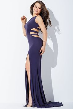 This Jovani JVN36715 sleeveless jersey prom dress features a jewel neckline, with straps sweeping over the open back and across the cutout sides. The full-length skirt is fitted and showcases a high-thigh side slit and sweep train.