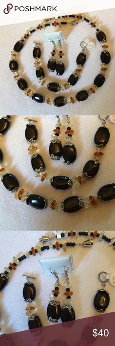 """Sold elsewhere, sorry! Black, clear and amber glass beads make this set special.  The 18"""" necklace has a secure twist closure and the 6.75"""" bracelet has a toggle.  The hook ER's dangle about 2"""".  This great set features contrasting glass beads, bead caps and SP findings.  Enjoy this yourself or if you can part with it, it would be a classy gift.  Thanks for stopping by. Lia Rosa Jewelry"""