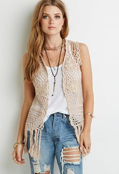 """Translation of hippie-chic style, this crochet vest will add a free-spirited touch to your look and breathe new life into even your most well-worn pieces. With crocheted flowers mixed in for a femme flair and a fringed hem for subtle movement, this piece is the perfect laid-back layer.  Lightweight knit 100% cotton 23.5"""" full length, 8"""" fringe length 37"""" chest, 35"""" waist Measured from Small Hand wash cold Model Info:  Height: 5'7"""" 