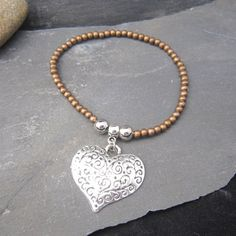 Hokte copper and silver expander bracelet with by HokteJewellery
