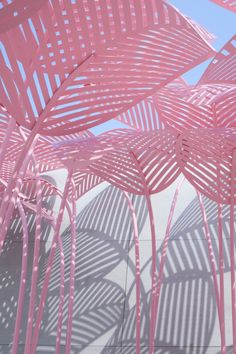 a pink, jungle-like daybed designed by Parisian/Italian artist and designer Marc Ange