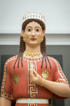 A reconstruction of an archaic, female tomb statue as she might have appeared in the middle of the 6th century B.C.
