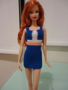 This hub is a free pattern for a Colorblocked Panel Sheath Dress for your Barbie Basics doll. It is made specifically for Barbie Model Muse body types.