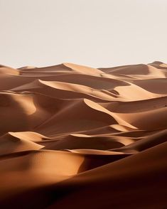 The calming curves of Abu Dhabi's mountainous dunes UAE. The calming curves of Abu Dhabi's mountainous dunes UAE. Desert Dunes, Brown Aesthetic, Desert Aesthetic, Foto Art, Landscape Photographers, Abu Dhabi, Beautiful World, Beautiful Scenery, Wall Collage