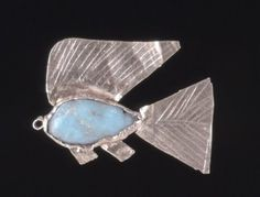 Gold and Feldspar Fish Amulet  Egypt  c.1900-1800 BC  12th Dynasty  Fish amulet representing the 'tilapia' or 'bolti' fish, called 'nekhau' in Egyptian. Made from sheet gold with green feldspar inlay. Has a ring at it's nose to be hung by.  Used as a charm against drowning by children. Fish amulets were often placed at the end of a plait on young children and young women. Also a symbol regeneration.  Source: British Museum