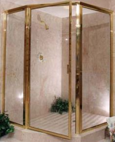 If I ever run into this eyesore - Our Suburban Cottage: How to re-paint a gold shower door surround.