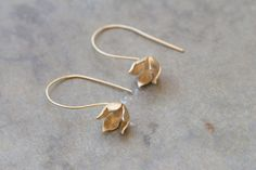 Check out this item in my Etsy shop https://www.etsy.com/il-en/listing/241997449/drop-gold-blooming-flower-earrings