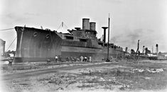 Starboard Bow view of Texas (BB-35) moored at pier during construction, 3 September 1912.