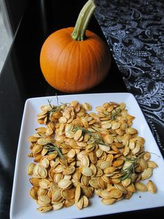 Pumpkin seeds from our homegrown pumpkins.  I roasted them with fresh rosemary (also from our garden). sea salt, olive oil, with a dash of nutmeg and cayenne pepper.