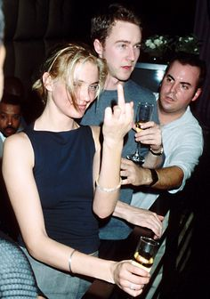 A young Cameron Diaz, flipping the bird, and Edward Norton attend a Tommy Hilfiger party in Miami.