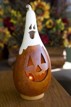 Casper Jack is a burnt orange jack-o-lantern with a white ghost on top. The Small Tall Lit is approximately 11 inches tall. All Caspers come with an electric light. All Caspers come with an electric light.