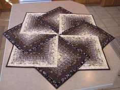 Table topper - gotta figure out this one - the fabric choice makes it SO effective