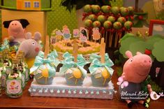 Candy apples at a Peppa Pig birthday party!  See more party planning ideas at CatchMyParty.com!