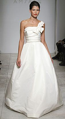 Amsale - Faille de Soie. One-shoulder Faille ball gown with draped bodice and asymmetrical bow. Flat-front skirt with chapel train. Available in Ivory as sampled and White.