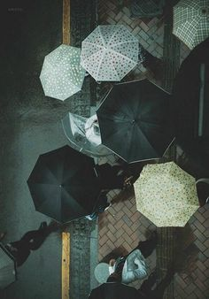 We like to think of this photo as the viewpoint of the raindrop. #umbrellas #rain
