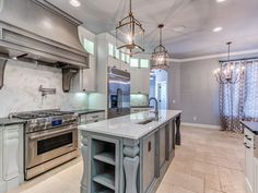 Traditional Kitchen with Mediterranean Walnut Pattern Honed-Unfilled-Chipped Travertine Floor and Wall Tile, Undermount Sink