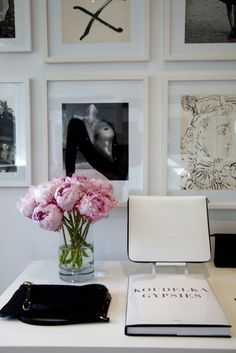 love the white frames and pink peonies