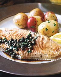 """Skate with Capers and Brown Butter """"Long a French favorite, skate is becoming increasingly popular with American cooks as they discover just how moist, succulent and flavorful it is. Ours is a classic French preparation—poached with herbs and sauced with a combination of pungent capers, vinegar and mellow browned butter. Boiled potatoes are the classic accompaniment."""""""