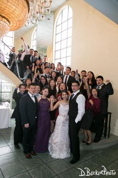 Group photo with the bride and groom on the Grand Staircase.  @dbeckerphoto