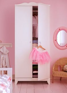 A white wardrobe in a children's room -- nice and basic, but pretty -- only about $120