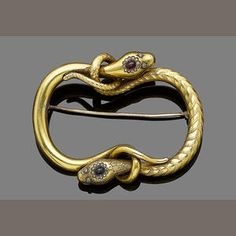 Two golden snakes entwine in a brooch to form a symbol of eternal love, 1850. (Bonhams.com)