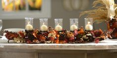 Serve family dinners this fall on a decorative table with our 5-Pillar Pumpkin Mix Centerpiece! This piece features leaves, pine cones and pumpkins, as well as placeholders for candles. Light your candles for a romantic autumn night!