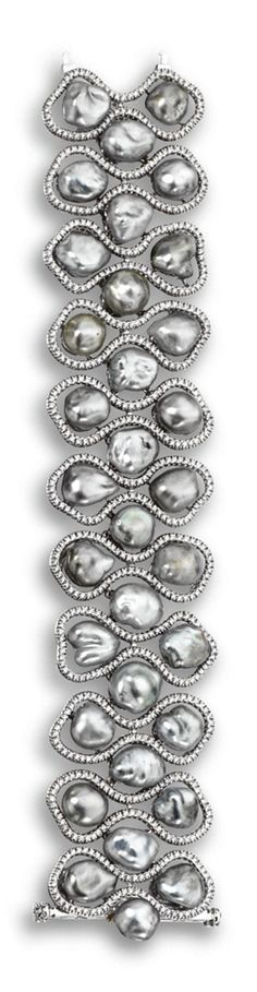 GRAY KESHI PEARL AND DIAMOND BRACELET.  Composed of 33 gray keshi pearls within borders of modified hourglass shape set with small round diamonds weighing a total of approximately 5.50 carats, mounted in 18 karat white gold, length 7 inches.