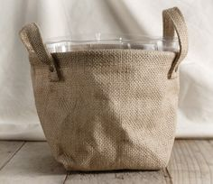Great way to cover those ugly nursery pots! Burlap Bag w/Handles and Liner 7.5in