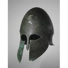 Greek Corinthian Bronze Helmet, circa early 5th Century BCE. William Herbert Hunt Collection (Sotheby's, New York).