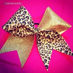 "Cheer bow of the day. by @sandyredski ""Gold & leopard with holo gold dots! Tag #cheerbowoftheday to be featured. #cheerbow #cheerbows #beautiful #cheer #cheerleading #cheerleader #cheerleaders #allstarcheer #fabric#allstarcheerleading #cheerislife #bows #hairbow #hairbows #bling #hairaccessories #bigbows #bigbow #teambows #fabricbows #hairclips #sparkle #instafashion #style #grosgrainribbon #dance#ribbon #instacute#instacheer"