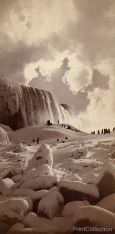 People on snow-covered ice at the base of the frozen American Falls, Niagara…