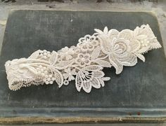 Simple, elegant lace garter; available in ivory or white. HOW LONG WILL IT TAKE? Each one is lovingly made to order. The standard creation +