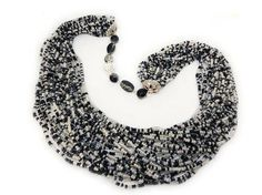 Black and white seed beads necklace - Multi layer necklace - Beaded chain  This unique black and white seed bead necklace delightful in its simplicity. This delicate necklace will adorn any girl and woman. It is easy, elegant jewelry suitable for everyday use and special occasions. Is handmade especially for you.  ◆MEASUREMENTS Length 26.77 inch ( 68 cm ) Weight 0.37 lb ( 170 g )  Each purchase comes carefully packaged.  ◆Please note that real colors may slightly differ from their appearance…