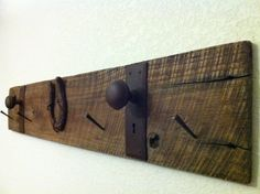 Rustic Reclaimed Barn wood coat rack hanger by JsReclaimedProject - Love the horse shoe nails as the hooks!