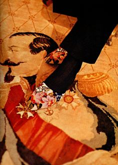 Baron Philippe de Rothschild's evening slipper on a 19th century carpet incorporating an image of Napoleon III. Taken from Vogue's Book of Houses, Gardens, and People. Photo: Horst.