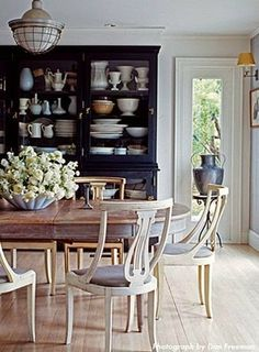 Lovely dining room with palette of Blues.  Love the display of China and serving dishes.