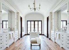 Bathroom Wood Floor: The bathroom floor is a natural wood flooring from Premiere…