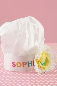 cute for the cooking party.....use stickers for the names & make flower embellishments for girls hats out of cupcake liners! LOVE
