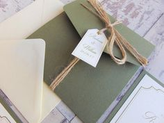 A classically elegant invitation set in sage green and ivory. This design would look stunning in any colour and would definitely bring some class to your big day! This sample invitation is a pocketfold invitation and includes 3 inserts - an RSVP card, accommodation and information.   To see a sample of this invitation, please order via this listing along with your full name, fiancés name, wedding venue and date so that I can personalise your sample. The following items are also available in…