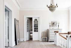 While the palest cream wall color keeps the room plenty bright and makes the pure-white crown molding pop.