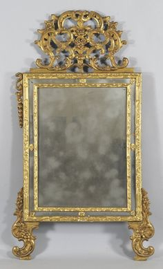 Specchiera in legno intagliato e dorato, Piemonte (Italia).  Sec.XVIII (piedi e cimasa rifatti) cm. 90x170 : Lot 1245