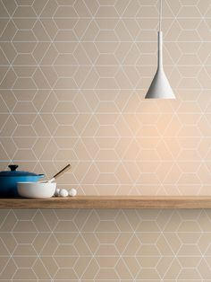 Cava is a tile collection designed by LucidiPevere for Spanish company Living Ceramics that features graphic patterns engraved on each piece of tile.