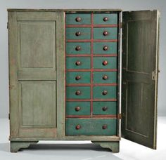 Painted apothecary cupboard, New England, early 19th century, thirty drawers with wooden pulls, cutout bracket base restored, 61.5 in. high