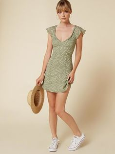 Hey little mama. This is a mini length, fit and flare dress with a ruffle edged v neckline.