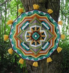 This mandala has a theme of Springtime in the forest, when flowers bloom, and all life is awakening to a new season. Its on a 24 inch frame, and is